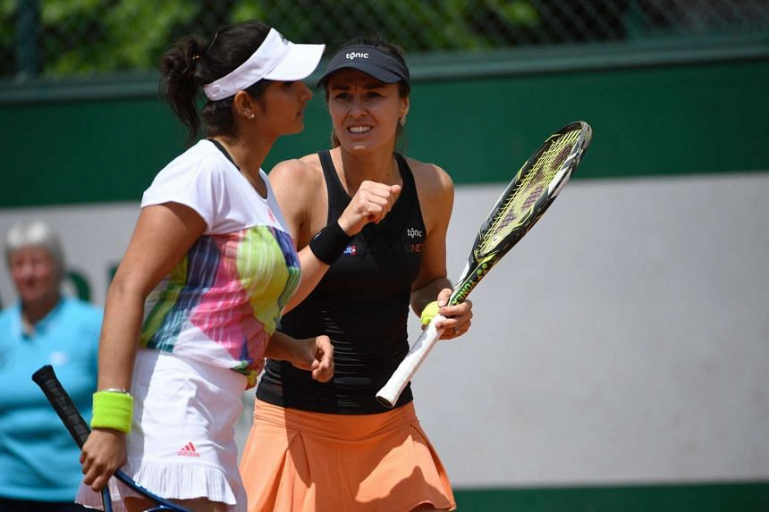 Sania Mirza and Martina Hingis during their first round doubles match at Roland Garros on May 25.