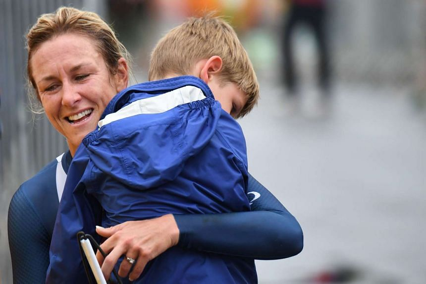 Kristin Armstrong celebrates with her son after winning the women's individual time trial event.