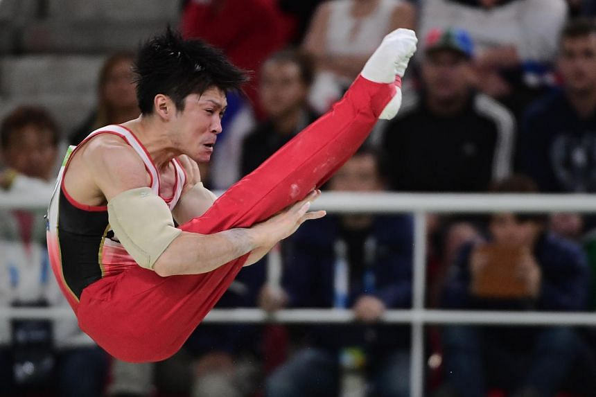 Japan's Kohei Uchimura competes in the parallel bars event of the men's individual all-around final at the Olympic Arena during the Rio 2016 Olympic Games in Rio de Janeiro on August 10.