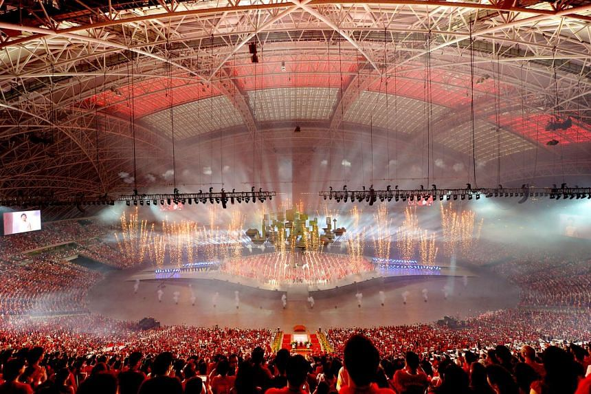 The Singapore flag is projected onto the roof of the National Stadium during an NDP Preview Show.
