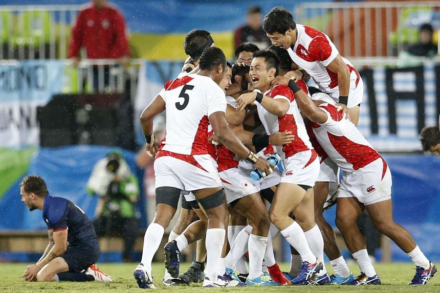 Players of Japan celebrate their win after the men's rugby sevens quarter-final match against France at the Rio 2016 Olympic Games, on Aug 10, 2016.