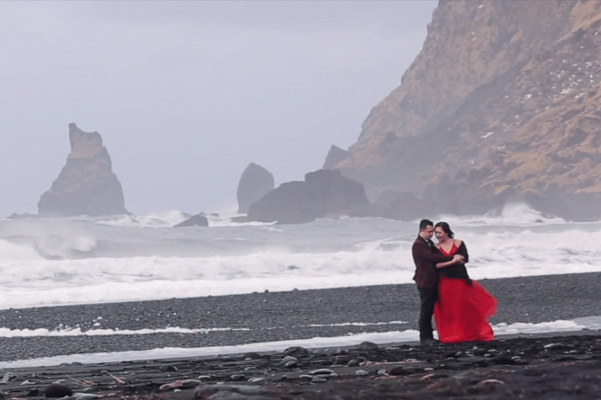 Canadians Cici and Clement in a pre-wedding photo shoot against the backdrop of the Black Sand Beach in Iceland.