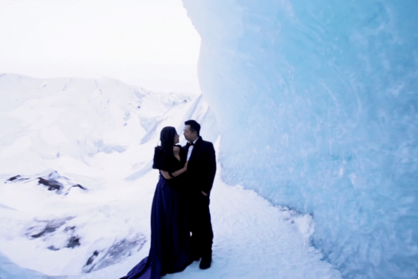 Bride-to-be Cici in a dark blue gown that goes with Iceland's glacier caves.