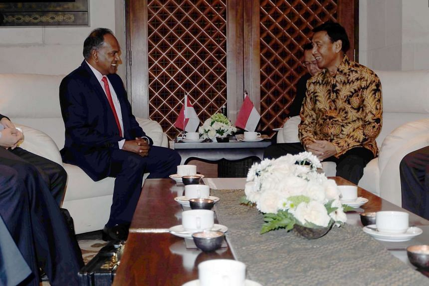 Mr Shanmugam meeting Mr Wiranto in Bali yesterday. The Indonesian minister said officials agreed on the importance of prevention efforts across borders, adding that ''if we do not cooperate, we would be beaten by the terror network''.