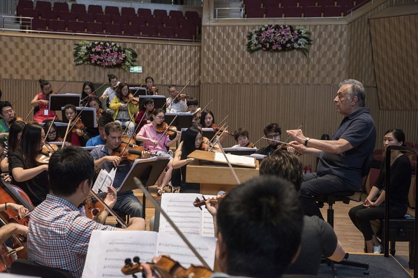 Zubin Mehta (right) conducting the Harbin Symphony Orchestra during rehearsal in the Chinese city.