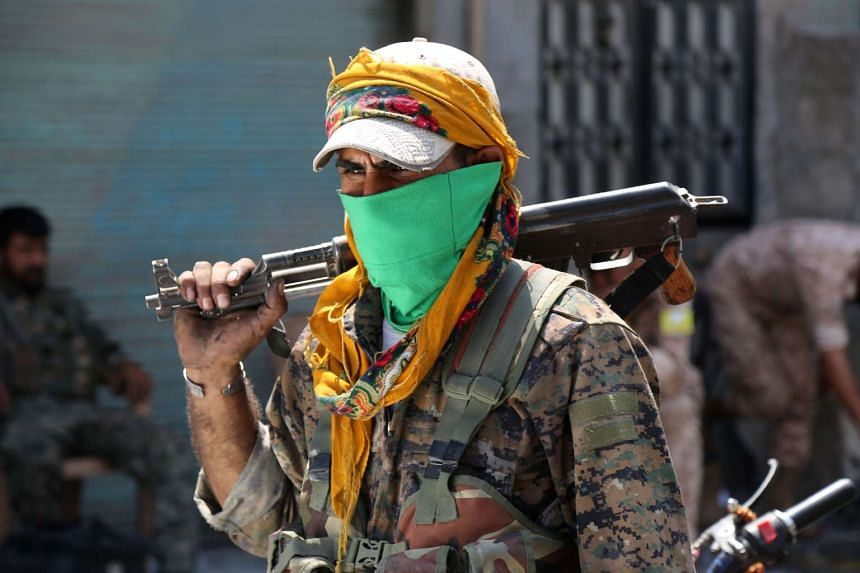 A Syrian Democratic Forces fighter in Manbij, northern Syria, on Aug 7, 2016, as forces combed the city in search of remaining ISIS militants.
