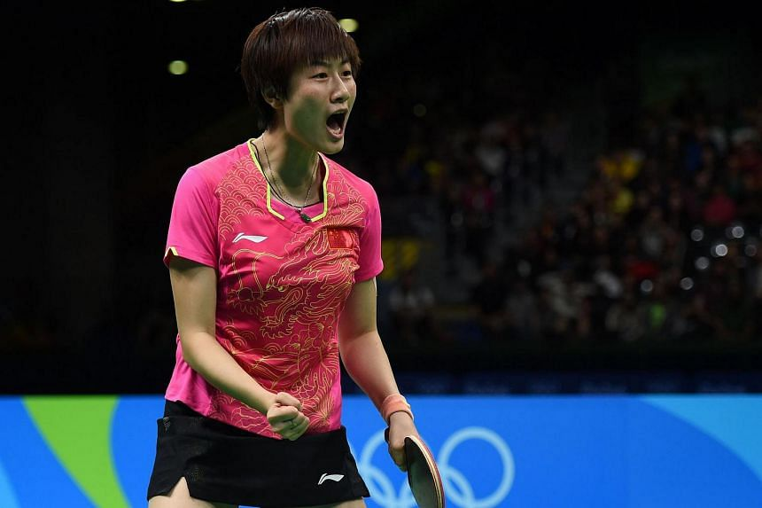 China's Ding Ning celebrates after winning the gold medal in the women's singles table tennis final.