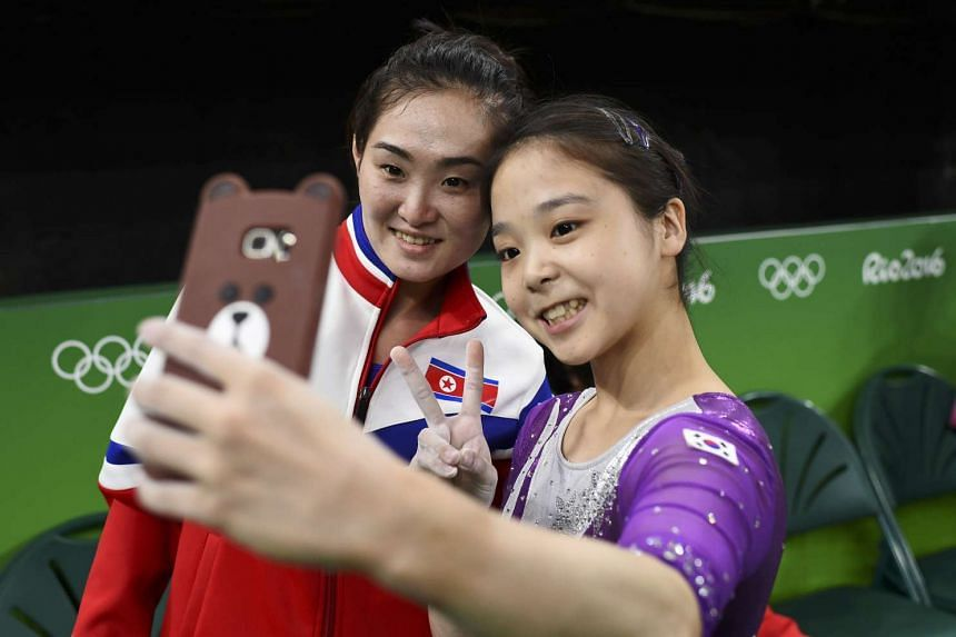Lee Eun Ju of South Korea (right) takes a selfie picture with Hong Un Jong (left) of North Korea.