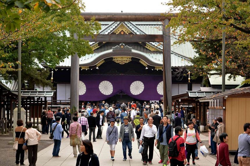 People visiting the controversial Yasukuni shrine during the shrine's autumn festival in Tokyo on Oct 17, 2015.