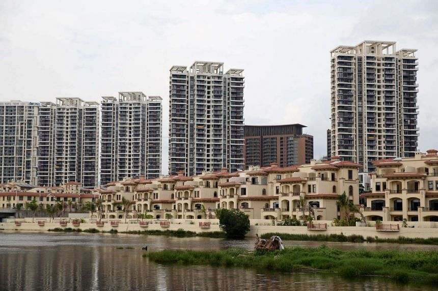 Low-rise and high-rise residential buildings stand at the Sea Shore of China development in the Sanya Bay district in Hainan, China.
