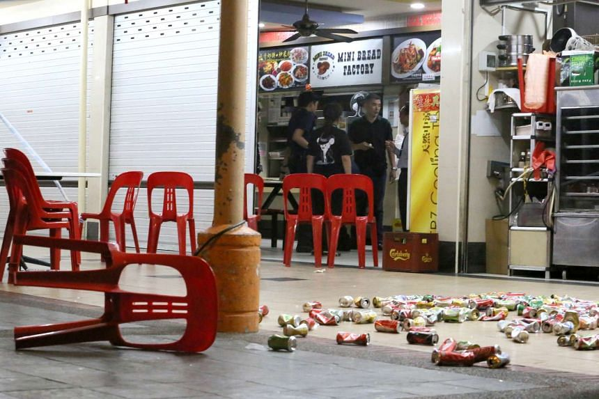 Drinks cans strewn at the coffee shop after two hawkers scuffled.