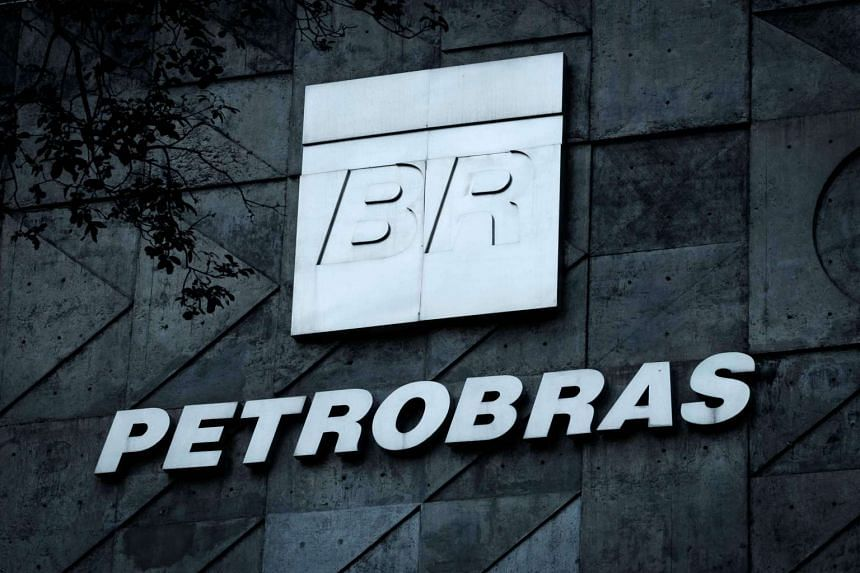 A logo of Brazilian oil company Petrobras is seen at the entrance of its headquarters in Rio de Janeiro.