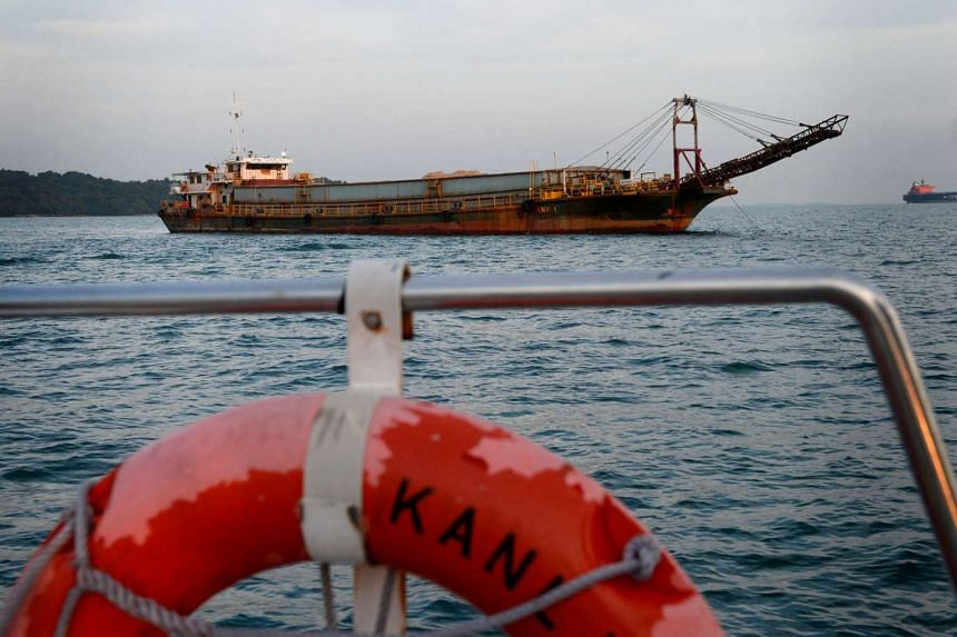 The sand barge named KNB 1, which carries sand meant for land reclaimation, anchored south of Pulau Sudong.