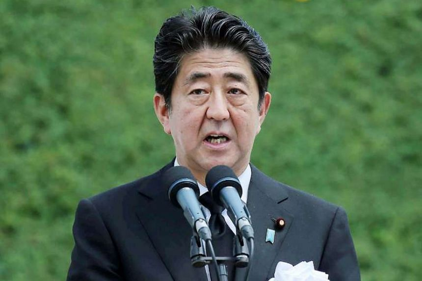 Japanese Prime Minister Shinzo Abe makes a speech during a memorial ceremony on the atomic bombing anniversary, at the Peace Memorial Park in Nagasaki, western Japan, on Aug 9, 2016.