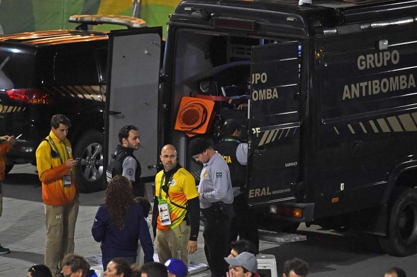 A bomb disposal truck of the Federal Police is pictured outside the Rio Olympics basketball stadium on August 11 as Brazilian security forces staged an apparent controlled explosion.