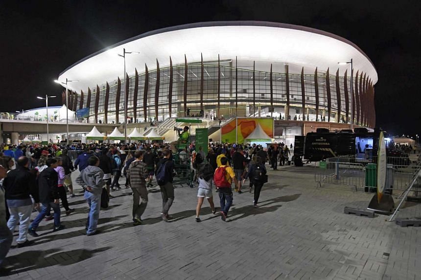 Spectators are pictured outside the Carioca Arena 1, where the basketball games are played, in Rio de Janeiro on August 11 during the Rio 2016 Olympic Games.