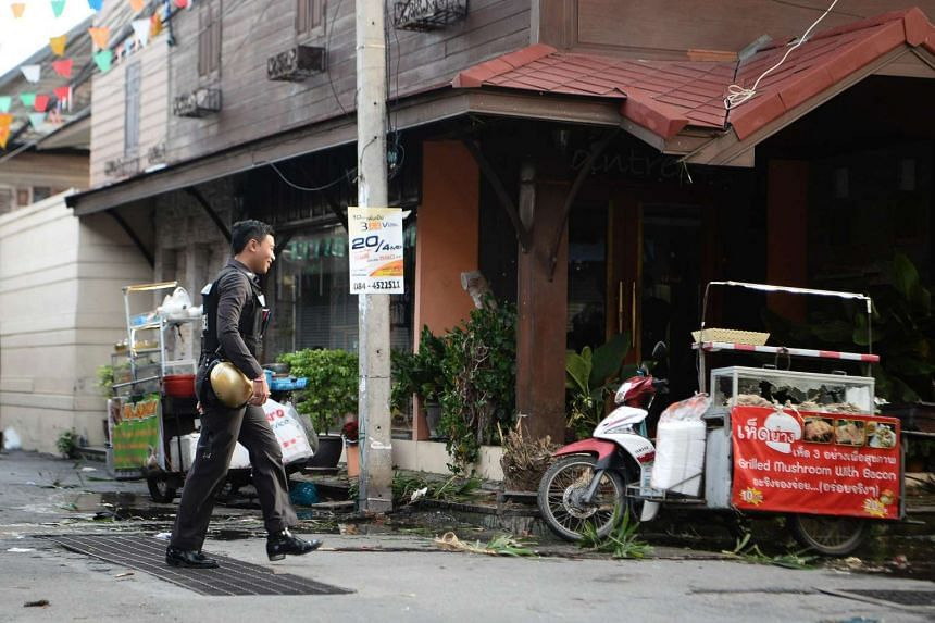 A Thai police stands guard where a small bomb exploded in Hun Hin on Aug 12, 2016.