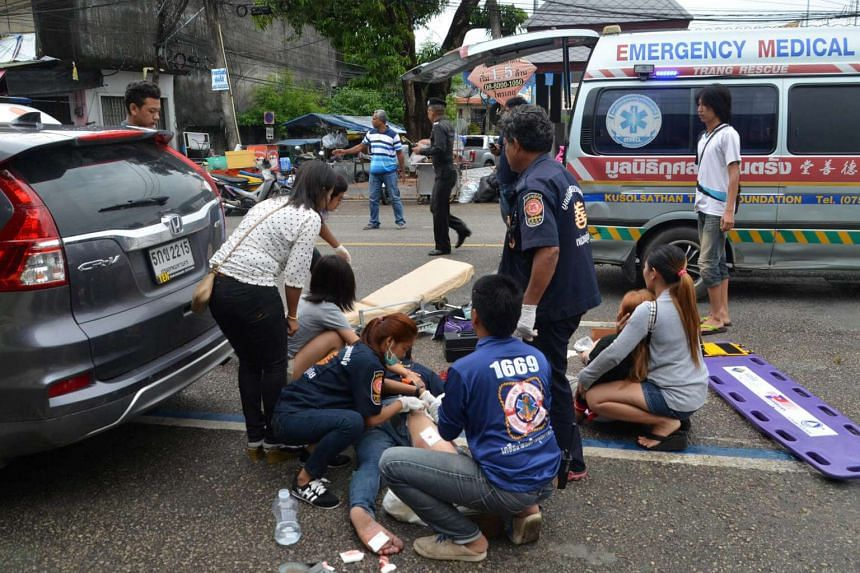 Injured people receive first aid after a bomb exploded on Aug 11, 2016, in Trang, Thailand.