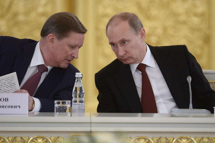 Russian President Vladimir Putin (right) on Friday (Aug 12) unexpectedly dismissed his powerful chief of staff Sergei Ivanov (left).
