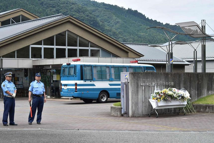 Policemen stand in front of the main gate to the Tsukui Yamayuri En care centre where a knife-wielding man went on a rampage in Sagamihara, Kanagawa prefecture on July 28, 2016.
