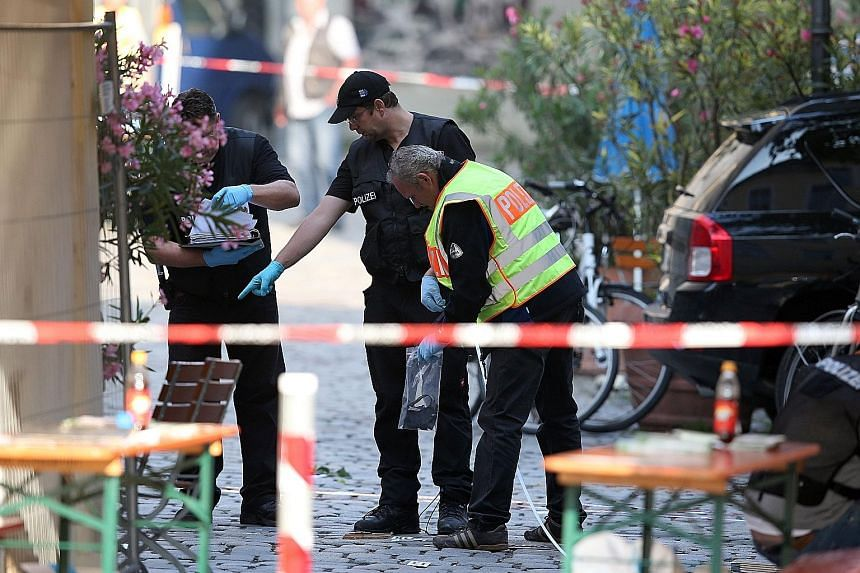 Investigators at the site of a suicide bombing in Ansbach, Germany, last month.