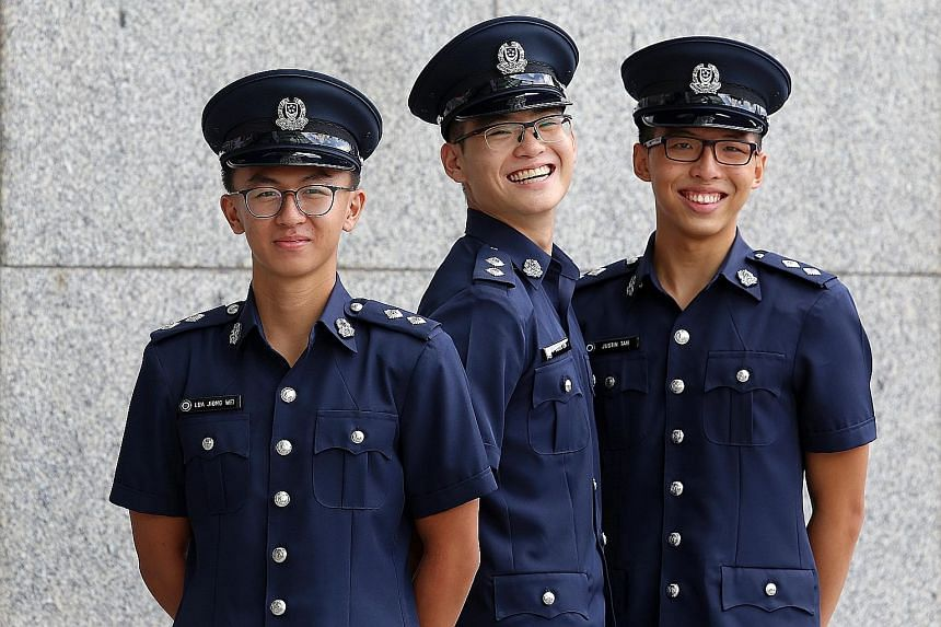 The three Singapore Police Force Scholarship recipients who received their awards yesterday (from left): Mr Lua Jiong Wei, Mr Kagen Lim and Mr Justin Tan.