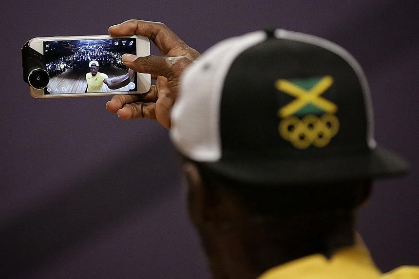 Jamaican star Usain Bolt taking a wefie with the media during a press conference held by the Jamaican Olympic Association at Cidade Das Artes on Monday.