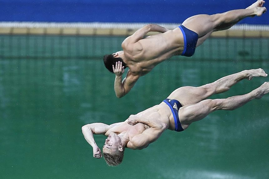 Britain's Jack Laugher and Chris Mears (top) plunging into the green waters of the diving pool. The organisers say too many people using it caused a drop in alkalinity.