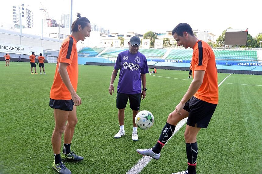 Hougang coach K. Balagumaran cutting a happy figure as he watched midfielder Fumiya Kogure and striker Stipe Plazibat train at the Jalan Besar Stadium yesterday. He has built a base this year and sees a lot of potential in the team.