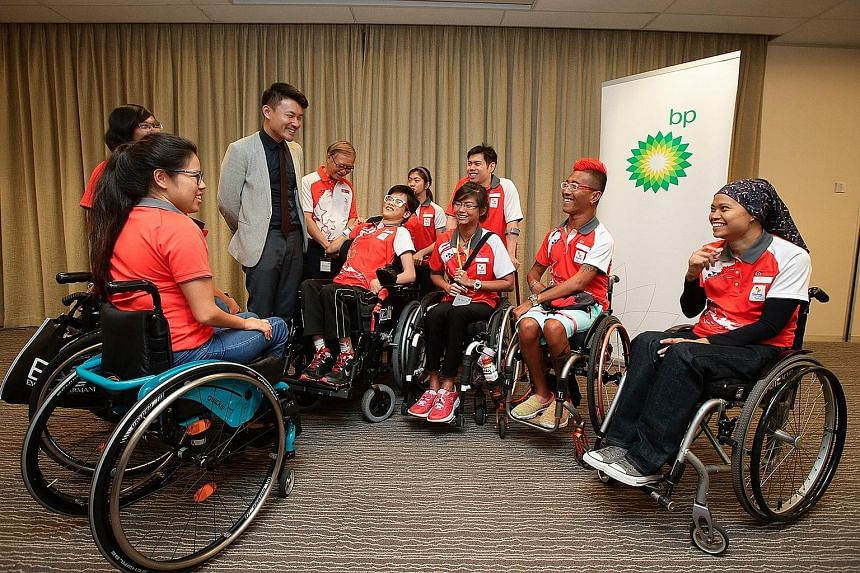 Parliamentary Secretary (Ministry of Culture, Community and Youth) Baey Yam Keng, with Singapore's Rio Paralympics chef de mission Ho Cheng Kwee on his left, sharing a laugh with (from left) swimmer Yip Pin Xiu, archer Nur Syahidah Alim, equestrians