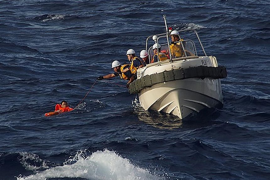 Japanese coast guard rescuing a crew member of the Chinese fishing boat that sank in waters near disputed islands in the East China Sea. China has expressed its appreciation for the rescue efforts.
