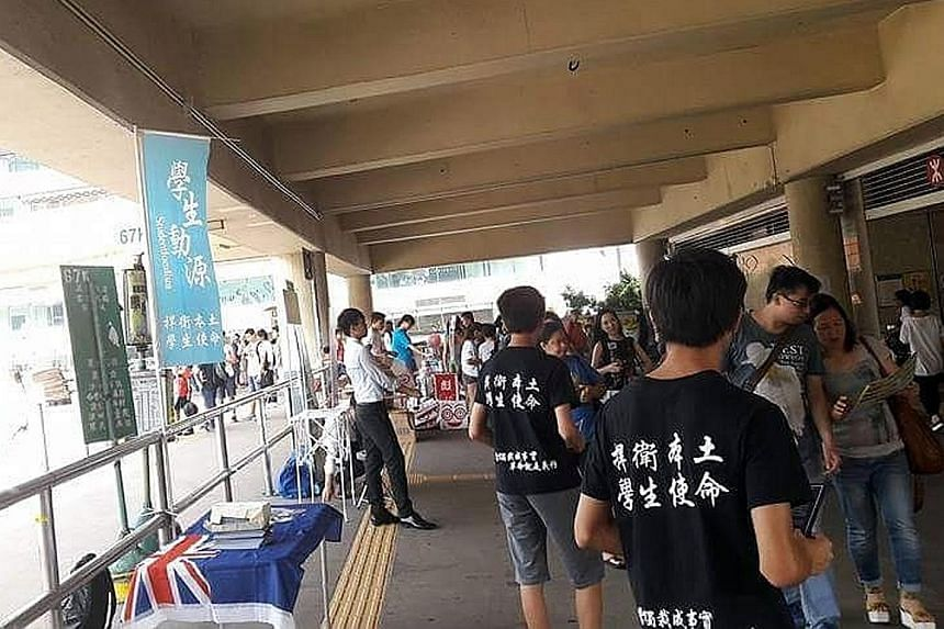 """Hong Kong activist group Studentlocalism, founded in April, has been taking to the streets to canvass for the city to break away from China. The words on the T-shirts read: """"Protect localism, the mission of students""""."""