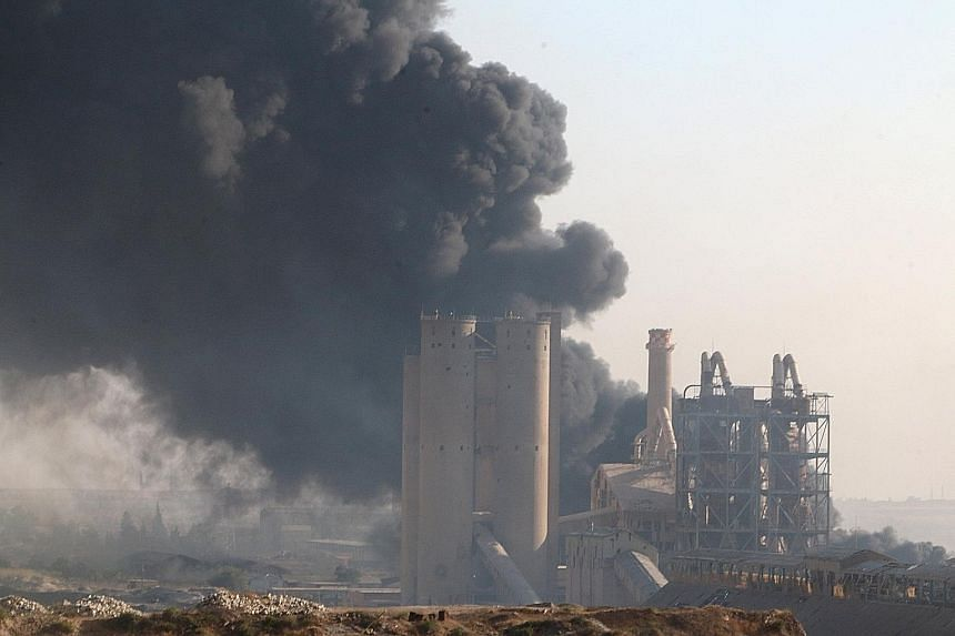 Smoke rising from a cement factory controlled by the Syrian regime in Aleppo. The battle for what was once Syria's largest city is seen as a crucial juncture in the ongoing conflict. But it is still unclear if the rebels can hold on to the recent gai