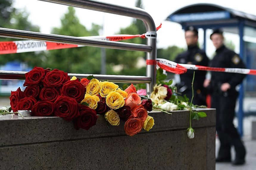 Flowers left in memory of victims of a shooting rampage near the Olympia mall in Munich last month. Germany has increased security measures in the wake of a series of terror attacks.