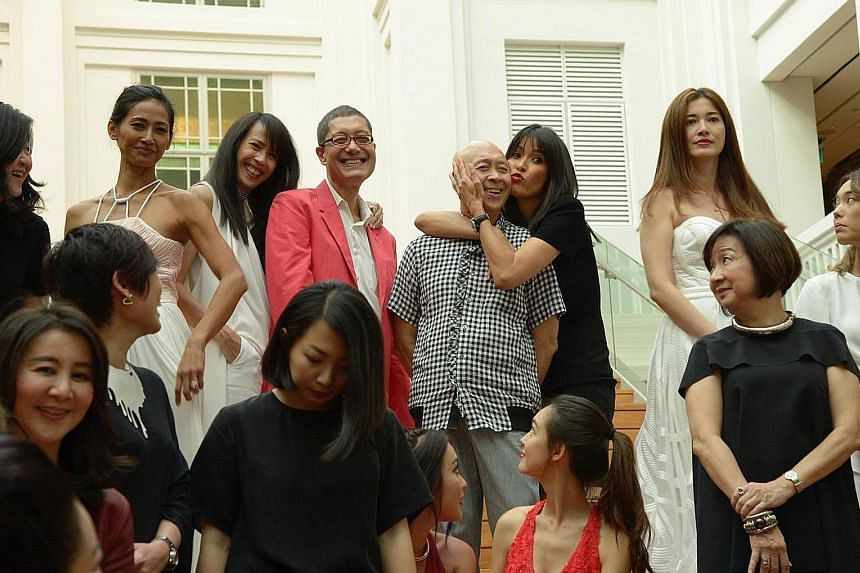 Former model Ethel Fong giving veteran fashion journalist Tom Rao an affectionate hug. Ms Fong said it was a huge honour to be a part of the event, which was organised to acknowledge the icons who have shaped Singapore's fashion industry.