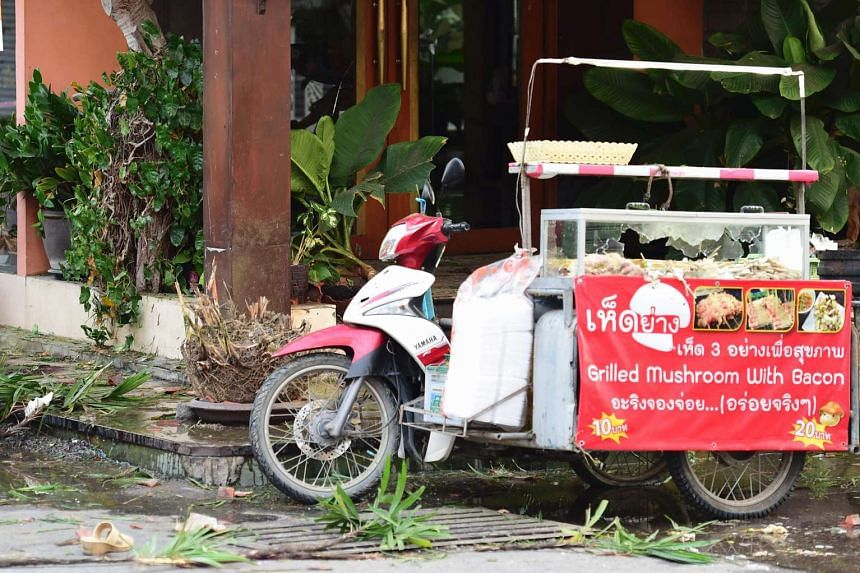 A damaged street food vendor stall is seen where a small bomb exploded in Hua Hin on August 12.
