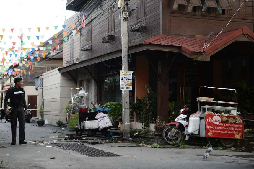 A Thai police stands guard where a small bomb exploded in Hun Hin on August 12.