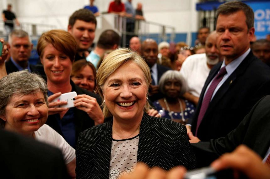 Clinton takes photos with supporters at Futuramic Tool & Engineering in Warren, Michigan, Aug 11, 2016.
