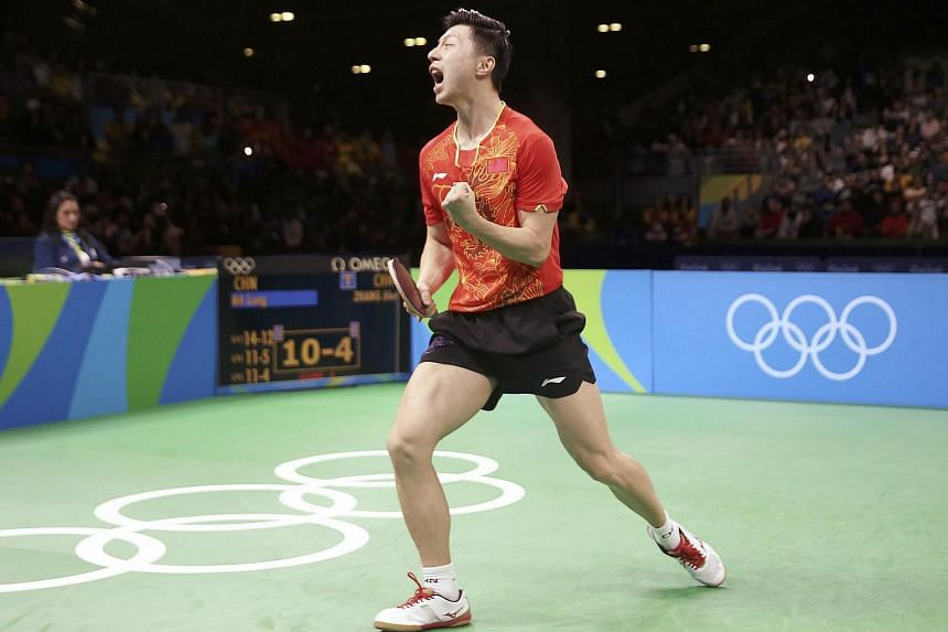 Ma Long of China celebrates after winning his match against Zhang Jike of China during the 2016 Rio Olympics.