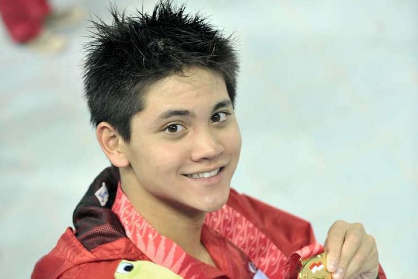 Joseph Schooling with the 50m butterfly gold he captured on the first night of the swimming programme. He ended up with two golds, a silver and a bronze.