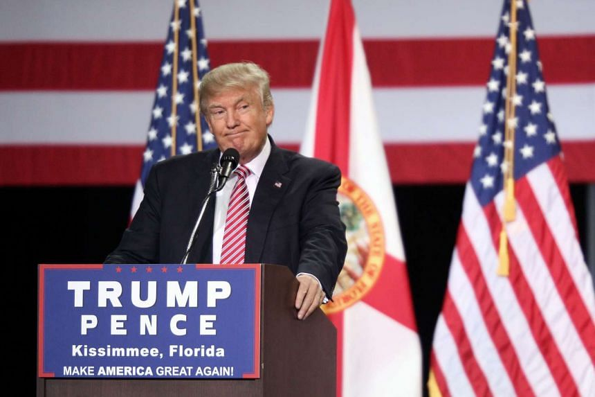Republican presidential candidate Donald Trump addresses supporters during a campaign rally at Silver Spurs Arena inside the Osceola Heritage Park in Kissimmee, Florida on Aug 11, 2016.