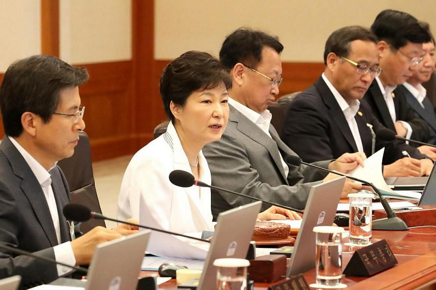 South Korean President Park Geun Hye (second from left) speaks at a Cabinet meeting in Seoul, on Aug 12, where special pardons were approved for more than 4,870 people.