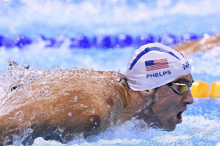 Michael Phelps won his fourth gold in the 200m individual medley, clocking a time of 1min 54.66sec.