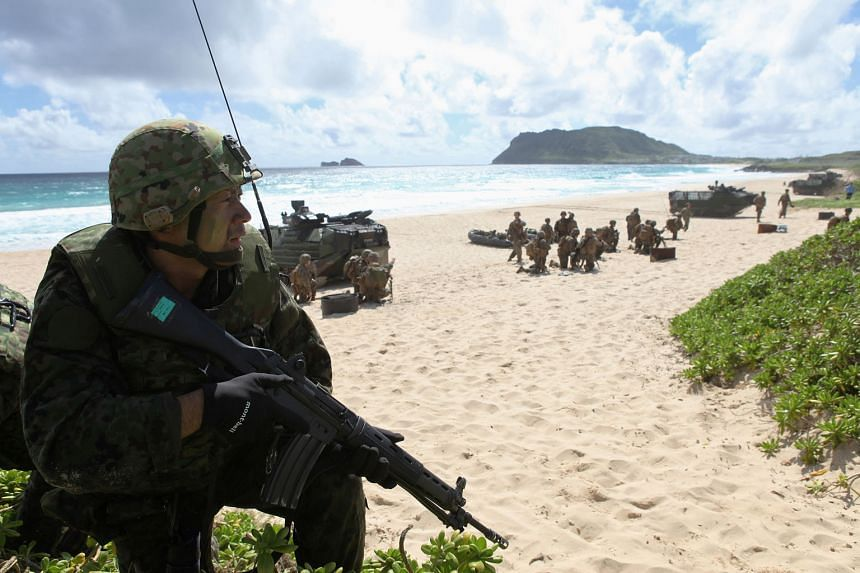 A soldier with the Japan Maritime Self-Defence Force training alongside US Marines in Hawaii last month. Japan's ruling Liberal Democratic Party and its junior coalition partner Komeito hold a two-thirds majority in Japan's Diet, and could initiate a refe