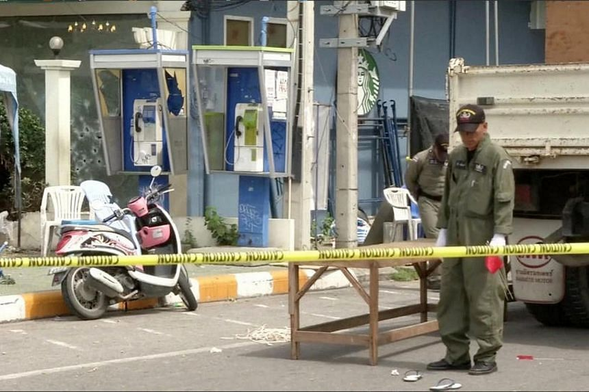 Police Explosive Ordnance Disposal (EOD) official inspects the site of a bomb blast in Hua Hin, south of Bangkok.