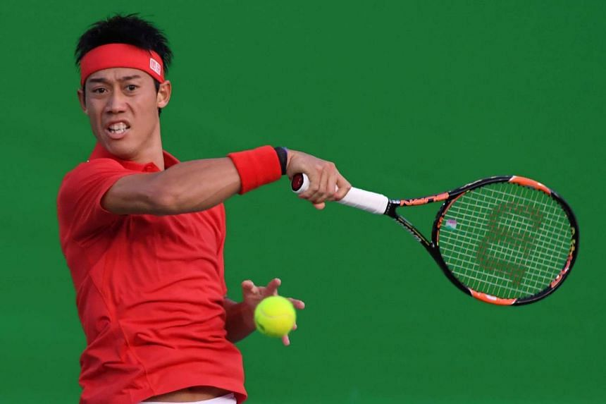 Japan's Kei Nishikori returns the ball to France's Gael Monfils.
