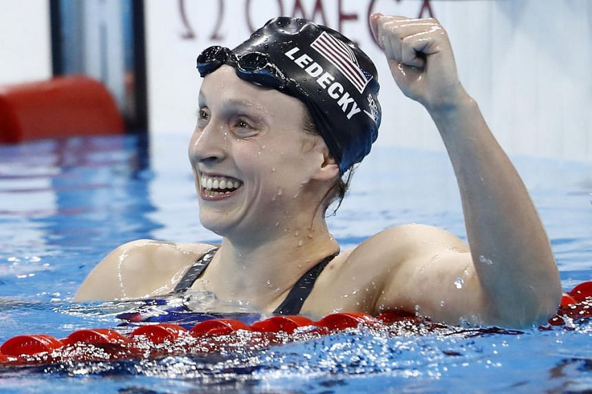 USA's Katie Ledecky celebrates after she broke the world record to win the Women's 800m Freestyle Final during the swimming event at the Rio 2016 Olympic Games at the Olympic Aquatics Stadium in Rio de Janeiro on Aug 12.