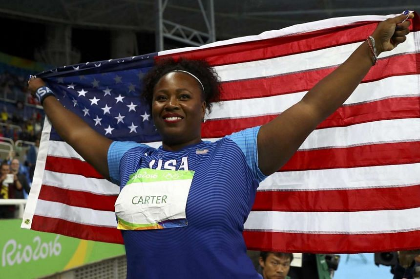Michelle Carter of USA celebrates after winning the gold medal in the women's shot put on Aug 12.
