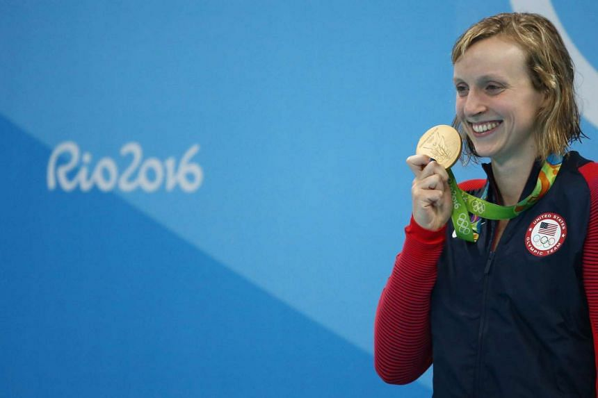 Katie Ledecky of USA poses with her gold medal from the women's 800m freestyle on Aug 12.