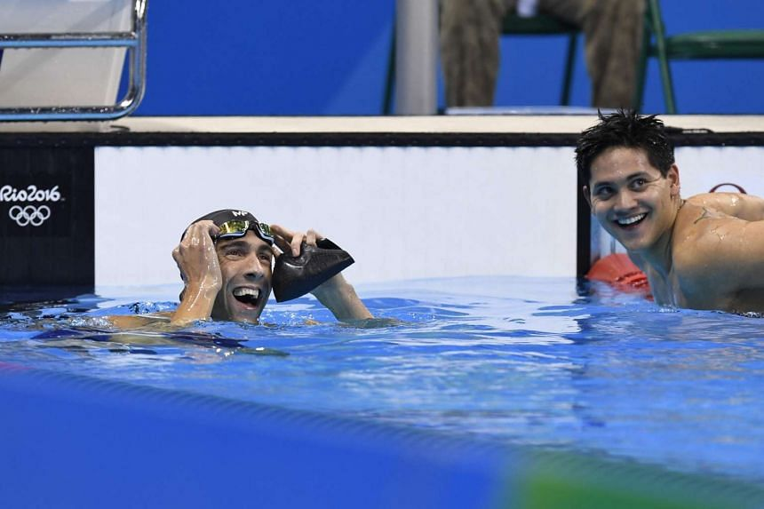 Joseph Schooling smiles next to USA's Michael Phelps (left) after the men's 100m butterfly final on Aug 12.